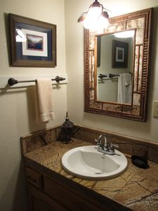 Newly updated bathrooms with granite tile vanities and ceramic tile tub/showers