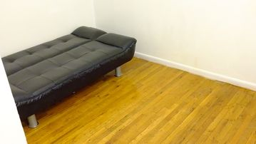 sofa bed in small living room area