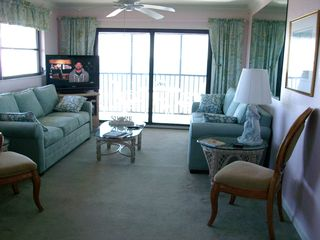 Sanibel Island condo photo - The living room with light blue/green furniture to complement the gulf.
