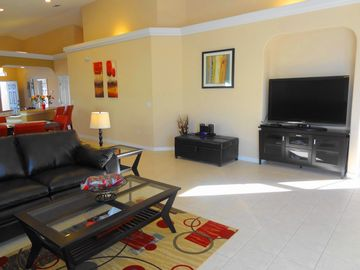 "Relax in the large living area and watch on a 55"" HDTV"