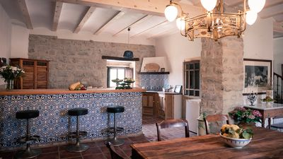 Typical Andalusian farmhouse surrounded by olive and fruit trees
