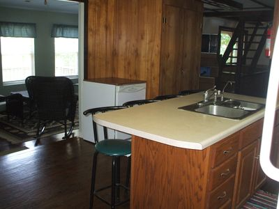 Kitchen Island with breakfast counter that sits 4