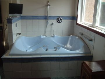 4 Person Jacuzzi tub in master bath with TV