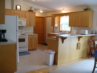 A like new home and only a 15 min. walk to nearby trails and ponds of Acadia.