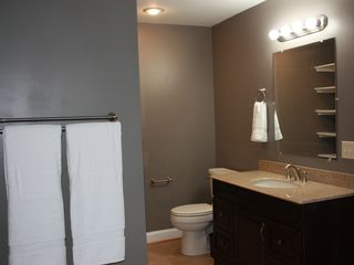 Harpers Ferry house photo - accessible downstairs master bathroom with stand up shower and granite vanity