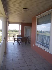 Large Balcony overlooking lagoon and 9th fairway w/butane grill.
