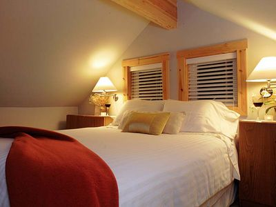 Loft Suite Bedroom, sumptuous and cozy! Enjoy views of Mt. Baker and the water.