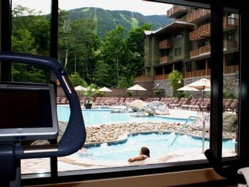 view of pool and mountain from fitness center