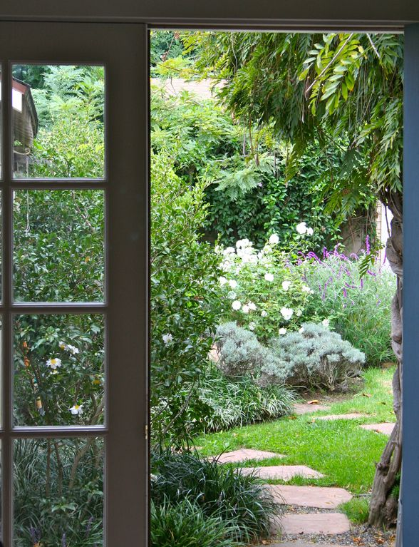 View from the kitchen sink out to your Secret Garden