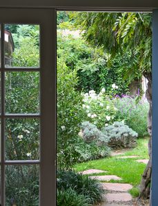 View out  to your Secret Garden Hideaway magical backyard