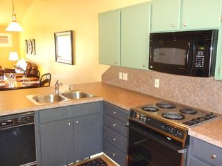 Twin Lakes condo photo - Fully equipped kitchen, new microwave and dishwasher.