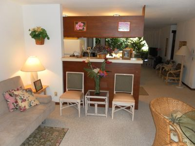 Living room to rear. Double futon to left.Teak kitchen cabinets---Trim-KOA wood