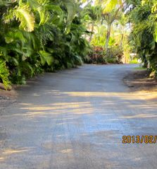 Haleiwa cottage photo - Private lane off the highway/ enter property- private gated entrance to cottage