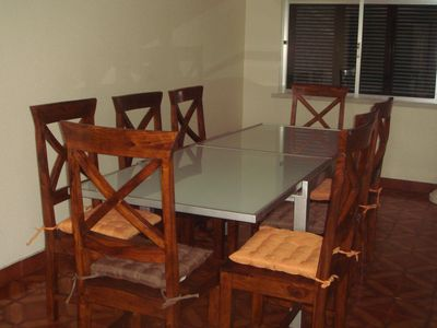 Dining Area with Large Glass table and 10 chairs