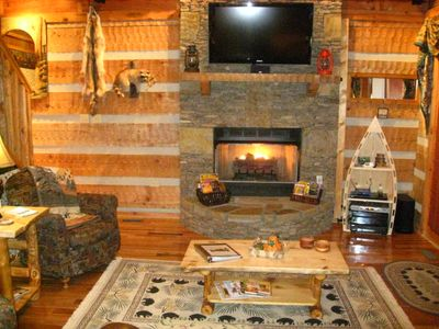 The Flat Screen HDTV with Surround Sound Home Theater and Fireplace