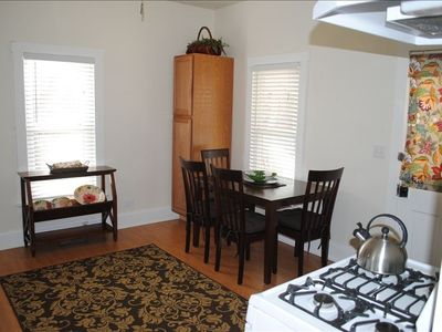 Bright open new kitchen. Access sun room, front porch, living space.