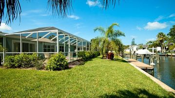 Anna Maria house rental - Backyard view of canal and pool.