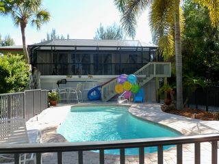 Sanibel Island house photo - Back view of our home, pool, deck with a high top table for 4 & screened porch.