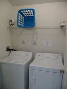 Washer, dryer, ironing board, iron, lots of pool towels!
