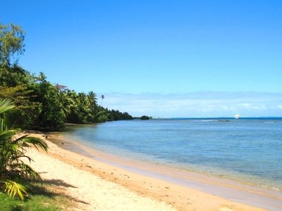 Fare Haapiti - secluded white sand beach and crystal clear lagoon