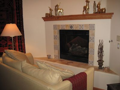 3rd sitting area in open living space with soft cotton sofa, gas fireplace