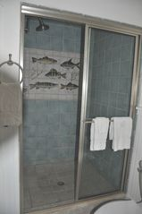 Stratton Mountain farmhouse photo - Master bath - large tiled shower in beach motive with hand-painted frieze