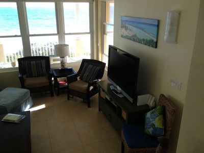 Large flat screen TV in great room with DVD and ocean view.