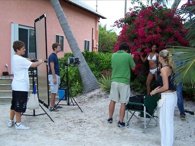 Sea Vista's Tyler(left) assisting in a swimwear model's shoot,one of many