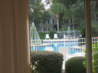 St. Simons Island condo photo - Relaxing view looking out over the patio and the heated pool.