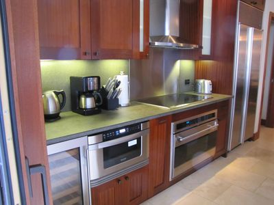 State of art kitchen: stainless steel & subzero appliances& wine cellar