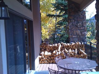 Front deck with your supply of firewood. - Keystone townhome vacation rental photo