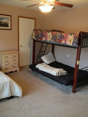 2nd Bedrrom on main floor with queen and futon bunkbeds for kids.Same 1rst floor