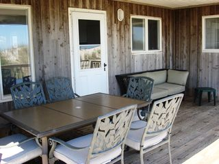 Brant Beach house photo - First floor screened-in porch dining table & seating