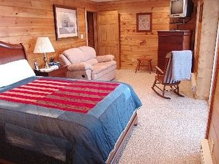 Fancy Gap cabin photo - Private Downstairs Suite With Bath and Door Leading Onto Covered Hot Tub Deck