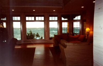 Living room at twilight with whitecaps on lake