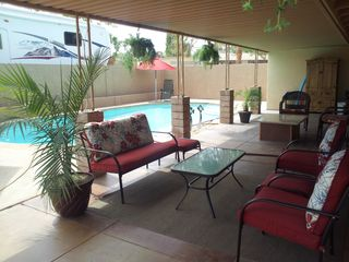 Henderson house photo - Private pool and patio area; grassy side yard; RV/boat parking