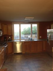 Duluth house photo - Kitchen with stainless steel Kitchen Aid appliances and silestone counter tops.