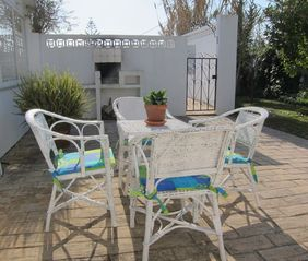 Casa da Figueira's private kitchen patio with build-in open-fire barbecue pit. - Praia da Luz Area villa vacation rental photo