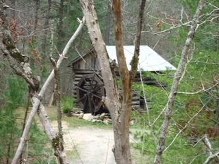 Bryson City cabin photo - The old 1800's cabin as you drive up to the Ridge Top Cabin. Wheel spins.
