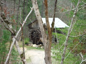 The old 1800's cabin as you drive up to the Ridge Top Cabin. Wheel spins.