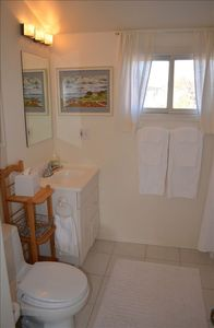 Separate full bathroom with ample towels. Shampoo