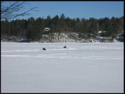 Snowmobiles on the lake during the winter.