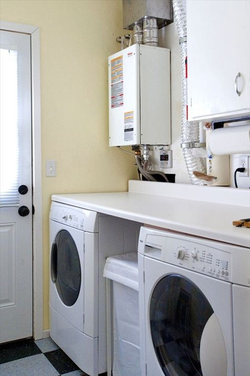Laundry Room with a door to the backyard.