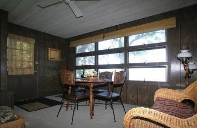 Three season porch with ceiling fan (windows on both sides of porch).