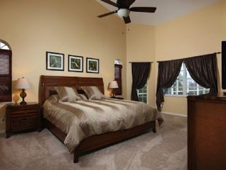 Vacation Homes in Marco Island house photo - Master bedroom suite with a king bed and high quality 5-star hotel type new mattress