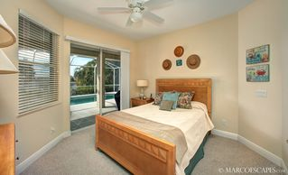 Vacation Homes in Marco Island house photo - Guest Bedroom One with Queen and Pool Access