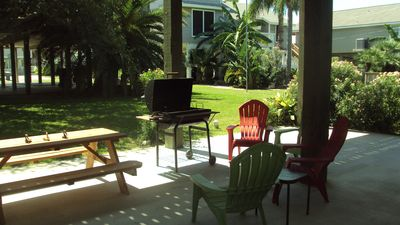 downstairs area with Grill, picnic table and chairs