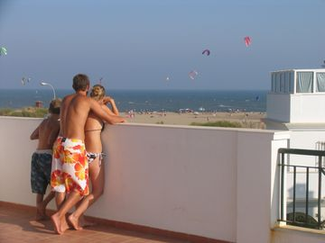 Watching Kite Surfers and Beach Activity from Roof