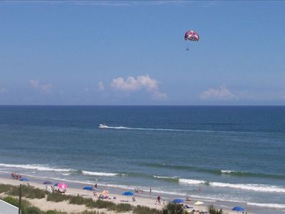 Paraglider & Beach viewed from your private Balcony.