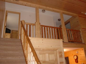 Stairs leading to second level with two bedrooms and full bath.
